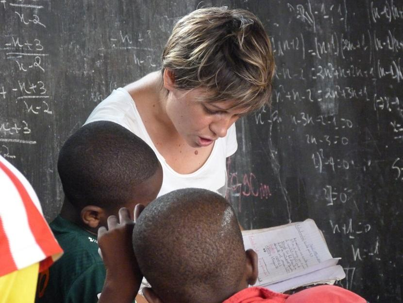 A Projects Abroad Care volunteer reads to children at a care facility in Togo.