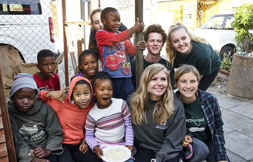 Projects Abroad volunteers spend time with children at a care center in South Africa