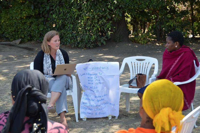 A Projects Abroad Human Rights volunteer from Canada gives a presentation on inheritance laws in Arusha, Tanzania
