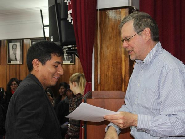 Local teacher receiving his certificate signed by the Regional Director of Education in Peru saying he completed the Teacher Training