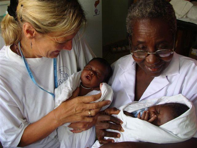 A Projects Abroad volunteer holds an infant at her Midwifery project in Ghana.