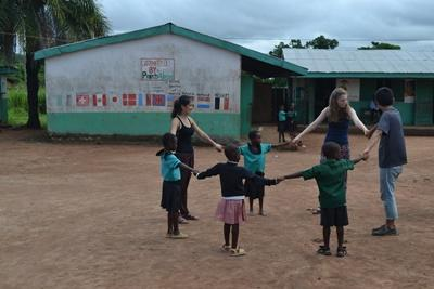 Projects Abroad volunteers play a game with Ghanaian children in Africa.