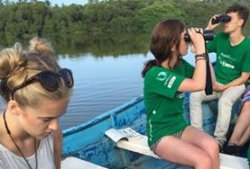A group of Conservation volunteers collect data for a study at a lagoon in Mexico.