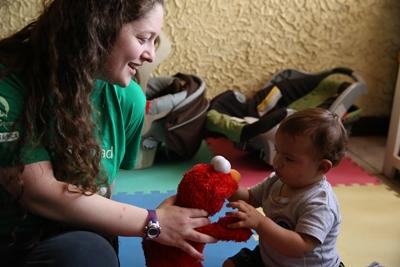 Projects Abroad Care volunteer spends time with a young baby at a care center in Costa Rica.