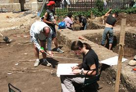 A volunteer records findings at an archaeological dig in Romania.