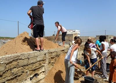 Volunteers work at a building site in Senegal.