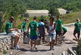 Volunteers build safer and cleaner bathroom facilities at a school in Jamaica.