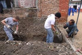 Volunteers help dig the foundation for a new classroom in Nepal.