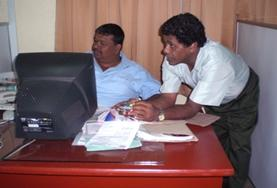 Local businessmen have a meeting at an internship placement in Sri Lanka.