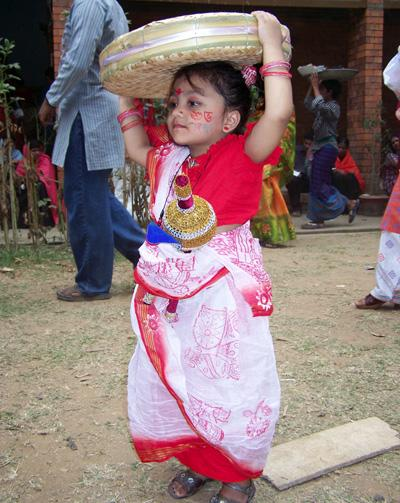 A young girl takes part in celebrations for Naba Barsha, the Bengali New Year, a national holiday in Bangladesh
