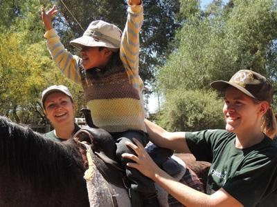 Volunteer on the Equine Therapy project in Bolivia helping special needs children