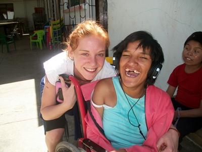 Volunteer with Special Needs girl in a wheelchair in Bolivia