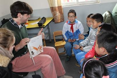 Chinese children enjoy story time at a Care placement.
