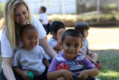Care volunteer and the children at her care placement in Costa Rica enjoy the outdoors together