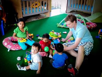 Volunteer in childcare with young  kids in Ecuador with Projects Abroad