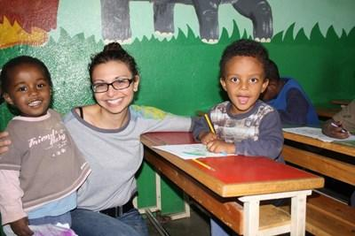 Volunteer doing an educational activity with kids in a childcare facility in Ethiopia, Afirca