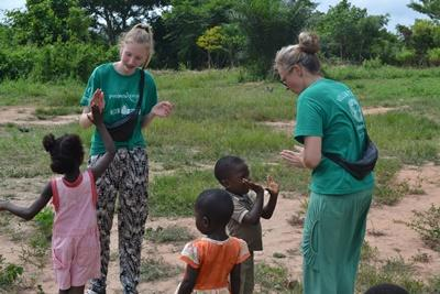 Projects Abroad family volunteers play with children at a Care placement in Ghana.
