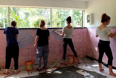 Projects Abroad Care volunteers paint a room at Sukitha Children's Orphanage in Sri Lanka