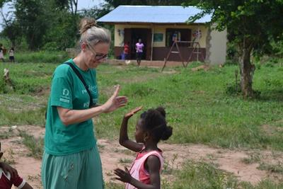 Projects Abroad volunteer plays with a child at an orphanage placement in Ghana, Africa.