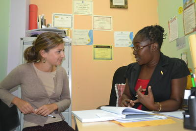 A volunteer speaks to a staff member in Jamaica