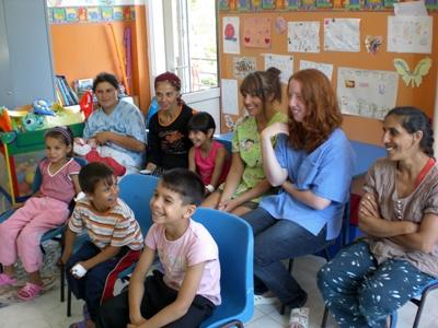 Volunteers in a lesson with kids and staff in an orphanage on the Care project in Romania