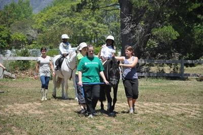 Volunteers help a group of disabled children during a session at the Equine Therapy Project in South Africa