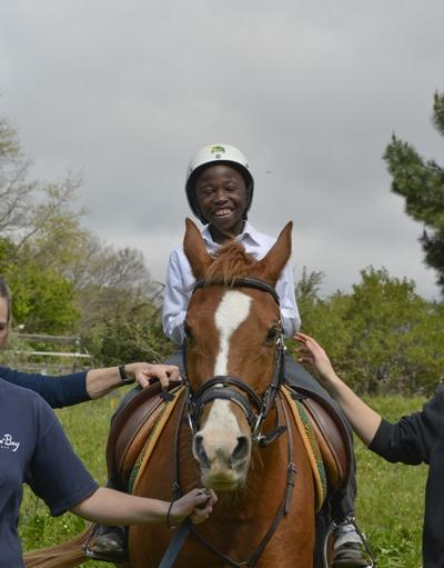 Local child participates in an equine therapy session at a center in South Africa