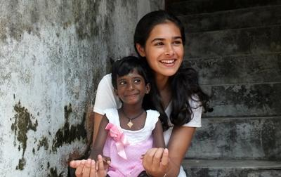 Volunteer with a young Sri Lankan girl in a care center on the Care project
