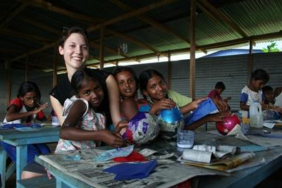 Volunteer with young girls in a care center in Sri Lanka on the Care Project