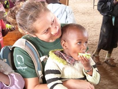 Volunteer with a young boy in a kindergarten in Tanzania with Project Abroad