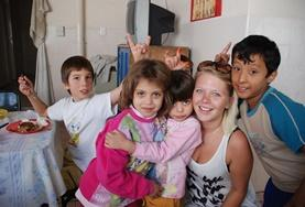 A volunteer spends time with children in Argentina.