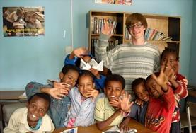A volunteer spends time with children in Ethiopia.