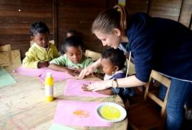 Children paint during a class with a volunteer in Madagascar.