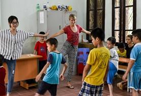Children learn exercises from volunteers at a special needs center in Vietnam.