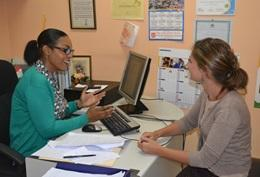 A volunteer discusses a case with a Children's Rights officer in Jamaica.