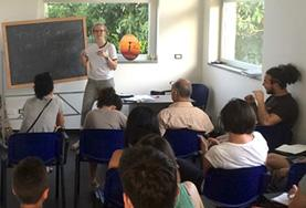 A volunteer teaches a language class for refugees and migrants in Italy.