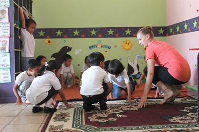 Young children in Ecuador participate in a dance lesson taught by a volunteer on the Creative Arts project.