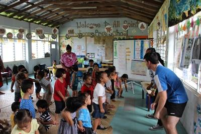 Projects Abroad Samoa volunteers run games for small children