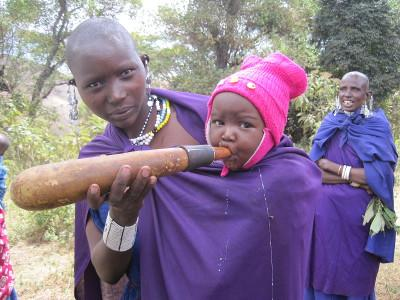 A young Masaai baby is fed by her mother in Tanzania, Africa.