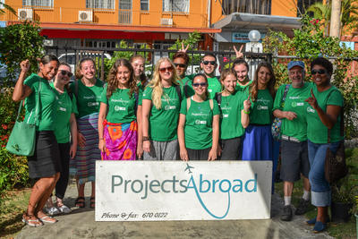 A group of professional volunteers and staff posing together on a volunteer abroad trip