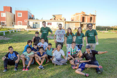 Sports team volunteering abroad together in coaching soccer in South America