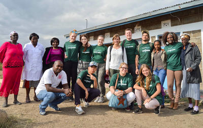 A group of college pre-med students volunteering together on a medical service project