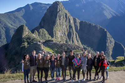 A group of volunteers posing together at Machu Picchu in Peru