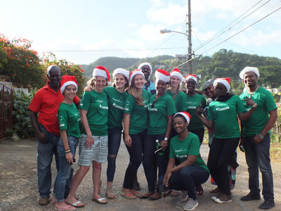 Projects Abroad volunteers pose for a photo in their Santa hats on a group trip to Jamaica