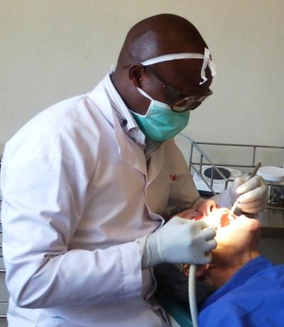 A Kenyan dentist conducts a checkup in Kenya, Africa.