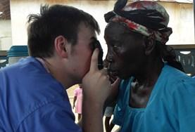 An intern on a Medical Elective abroad conducts an eye test on a local woman.