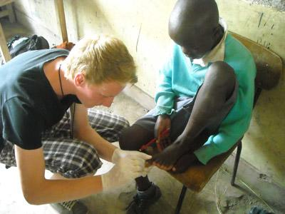 Medical Students does a medical checkup on a child in Kenya