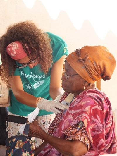 A Togolese woman receives treatment from a Projects Abroad intern on the Medicine project.