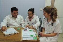 A volunteer with local staff on the Bolivia Medical School Elective.