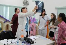 A doctor explains the results of an x-ray to Medical Elective students in Morocco